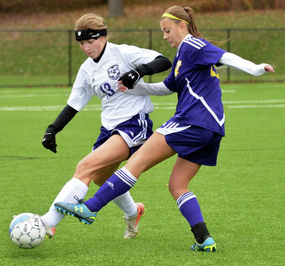 Catholic Central's #13 Claire Chaisson, left, and Voorheesville's #12 Zoe Fisher during the Section II Class B girls' soccer final at Lansingburgh High School Saturday Nov. 1, 2014, in Troy, NY.  (John Carl D'Annibale / Times Union) Photo: John Carl D'Annibale / 00029265A