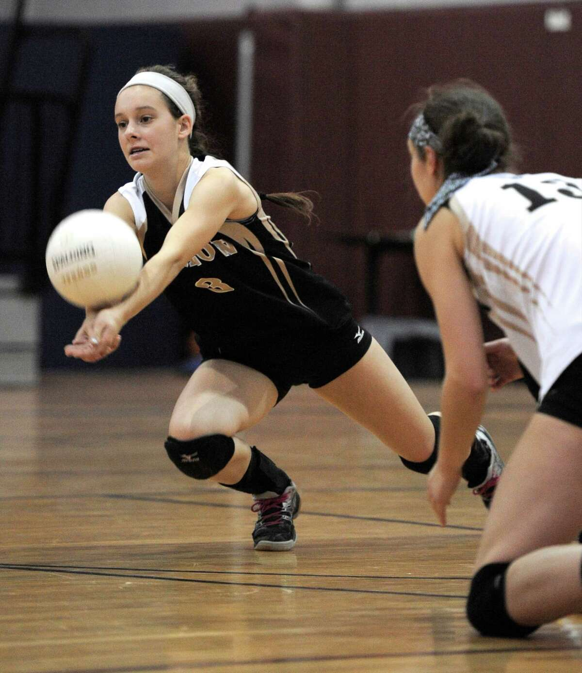 Barlow's Kristen Acocella (3) dives for the ball as team mate Kaitlyn Matino (13) looks on during the SWC girls volleyball Championship match between Weston and Joel Barlow high schools, on Saturday night, November 1, 2014.