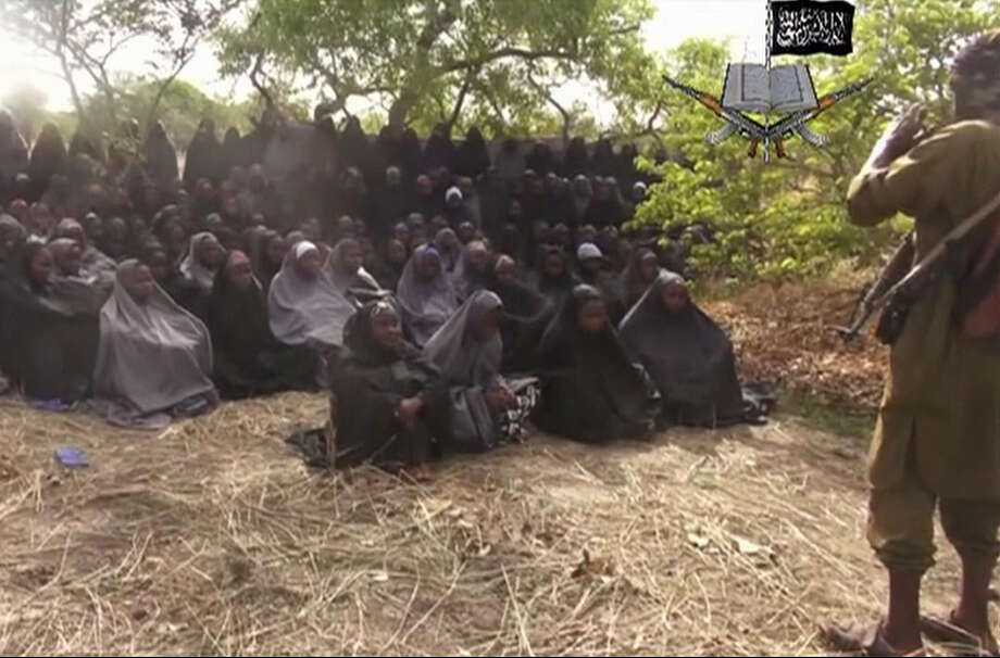 A May 12 image taken from video by Nigeria's Boko Haram terrorist network purports to show the schoolgirls who were abducted from the town of Chibok. Photo: Associated Press File Photo / Militant Video