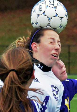 Catholic Central's #4 Sydney Moss heads the ball between two Voorheesville defenders during the Section II Class B girls' soccer final at Lansingburgh High School Saturday Nov. 1, 2014, in Troy, NY.  (John Carl D'Annibale / Times Union) Photo: John Carl D'Annibale / 00029265A