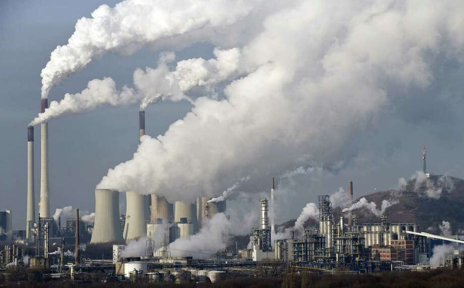 A power plant burns coal in in Gelsenkirchen, Germany. A U.N. panel concludes emphatically that humans are altering the Earth's climate system. Photo: Martin Meissner / Associated Press / AP