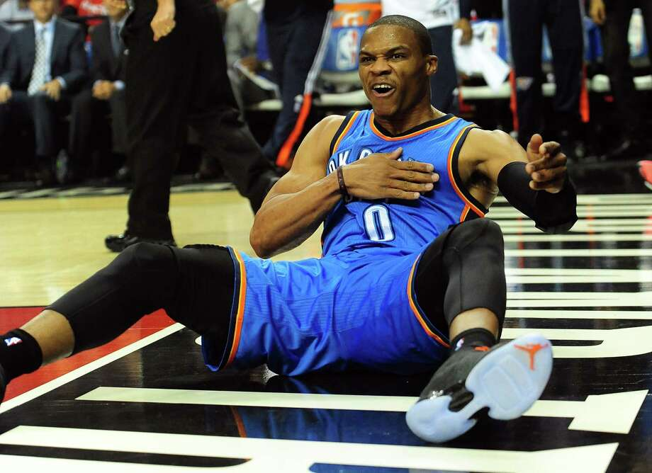 PORTLAND, OR - OCTOBER 29: Russell Westbrook #0 of the Oklahoma City Thunder celebrates after scoring in the first quarter of the game against the Portland Trail Blazers at Moda Center on October 29, 2014 in Portland, Oregon. NOTE TO USER: User expressly ackowledges and agrees that by downloading and/or using this photograph, user is consenting to the terms and conditions of the Getty Images License Agreement.  (Photo by Steve Dykes/Getty Images) Photo: Steve Dykes, Stringer / 2014 Getty Images