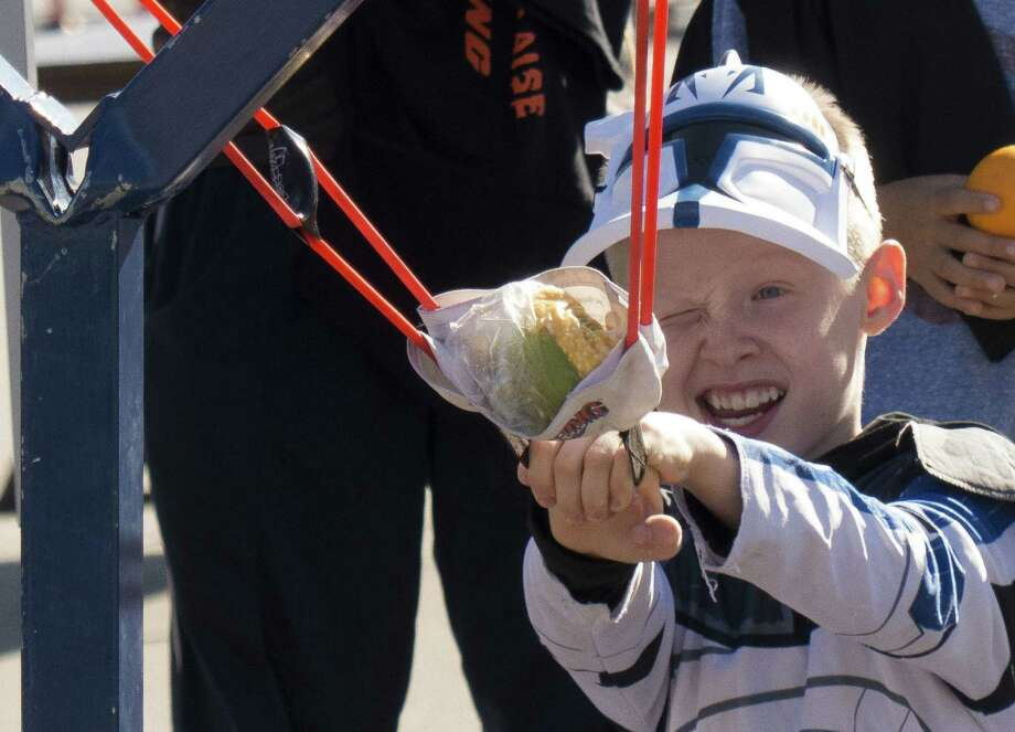David Richter, 10, takes aim with an oversized slingshot during the Monster Mash Pumpkin Smash and STEM Fest at UTSA. Photo: Photos By Billy Calzada / San Antonio Express-News