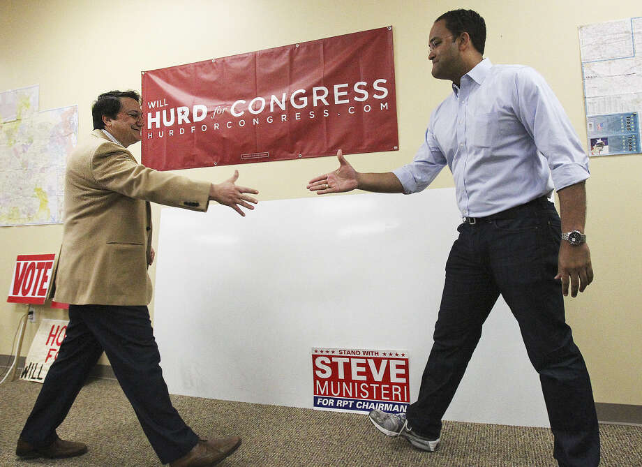 Republican congressional candidate Will Hurd (right) greets Steve Munisteri, chairman of the Texas GOP, as they gather sup- porters at Hurd's Hueb- ner Road campaign office for a door-to-door effort. Photo: Tom Reel / San Antonio Express-News