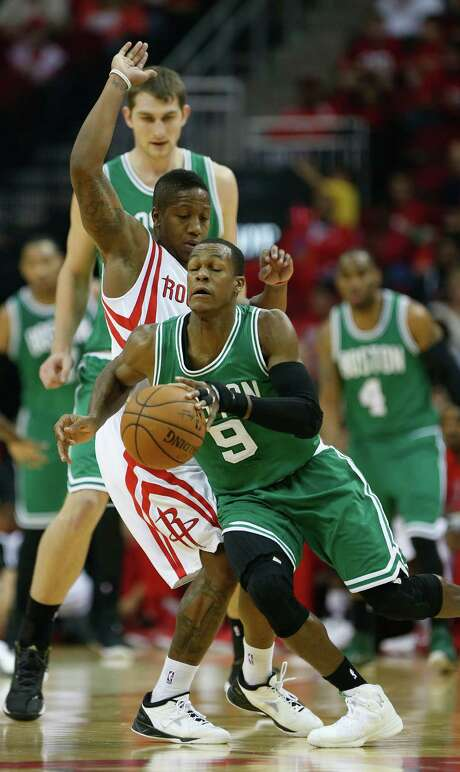 Celtics guard Rajon Rondo (9) finds it difficult to maneuver around the defense of the Rockets' Isaiah Canaan during the first half of Saturday's game. Photo: Karen Warren, Staff / © 2014 Houston Chronicle