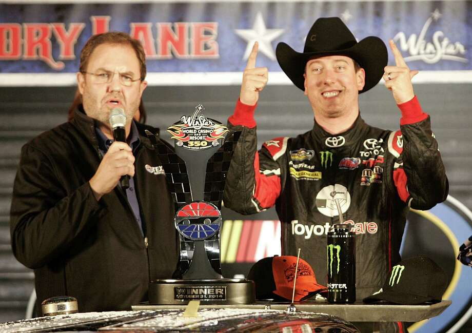Kyle Busch, right, celebrates in Victory Lane after the 16th Annual WinStar World Casino & Resort 350 at Texas Motor Speedway in Fort Worth, Texas, on Friday, Oct. 31, 2014. (Bob Booth/Fort Worth Star-Telegram/MCT) Photo: Bob Booth, STR / Fort Worth Star-Telegram