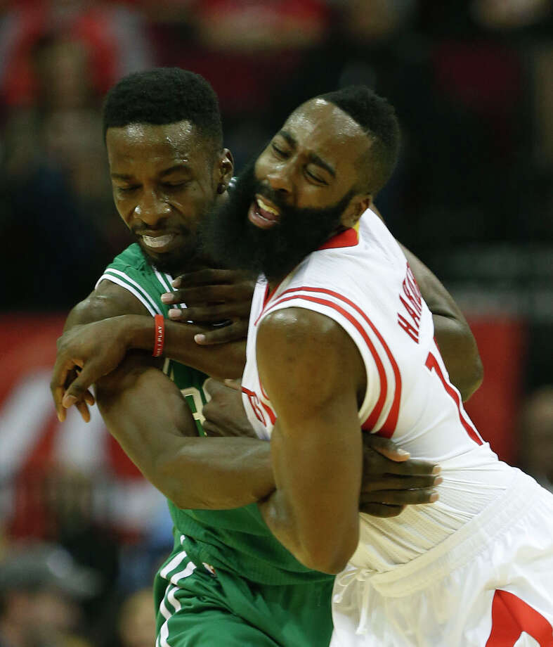 Despite having to contend with the Celtics' Jeff Green, left, James Harden put up glossy statistics in only three quarters of work Saturday. Photo: Karen Warren, Staff / © 2014 Houston Chronicle