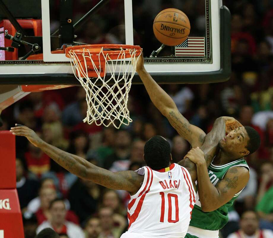 Rockets forward Tarik Black (10) defends the basket against Celtics guard Marcus Smart (36) during the first half. The Celtics shot 37.8 percent from the floor and were 1-for-25 from 3-point range. Photo: Karen Warren, Staff / © 2014 Houston Chronicle