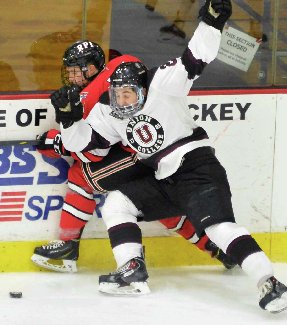 Union's #21 Mike Vecchione,right, and Rpi's #18 Travis Fulton tangle during Saturday's game at Messa Rink Nov. 1, 2014, in Schenectady, NY. (John Carl D'Annibale / Times Union)
