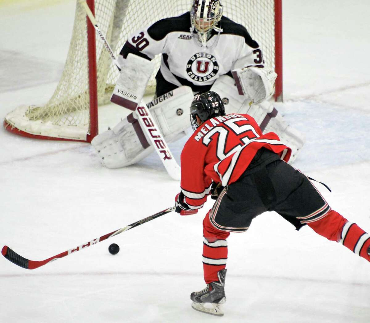 RPI's #25 Drew Melanson's shot is stopped by Union goalie #30 Colin Stevens during Saturday's game at Messa Rink Nov. 1, 2014, in Schenectady, NY. (John Carl D'Annibale / Times Union)