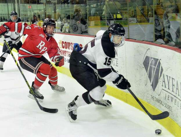 Union's #15 Spencer Foo, right, beats RPI's #24 Chris Bradley to the puck during Saturday's game at Messa Rink Nov. 1, 2014, in Schenectady, NY.  (John Carl D'Annibale / Times Union) Photo: John Carl D'Annibale / 00029290B