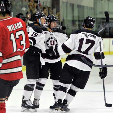 Union's #15 Spencer Foo, center, and team mates celebrate his goal in Saturday's game against RPI at Messa Rink Nov. 1, 2014, in Schenectady, NY.  (John Carl D'Annibale / Times Union) Photo: John Carl D'Annibale / 00029290B