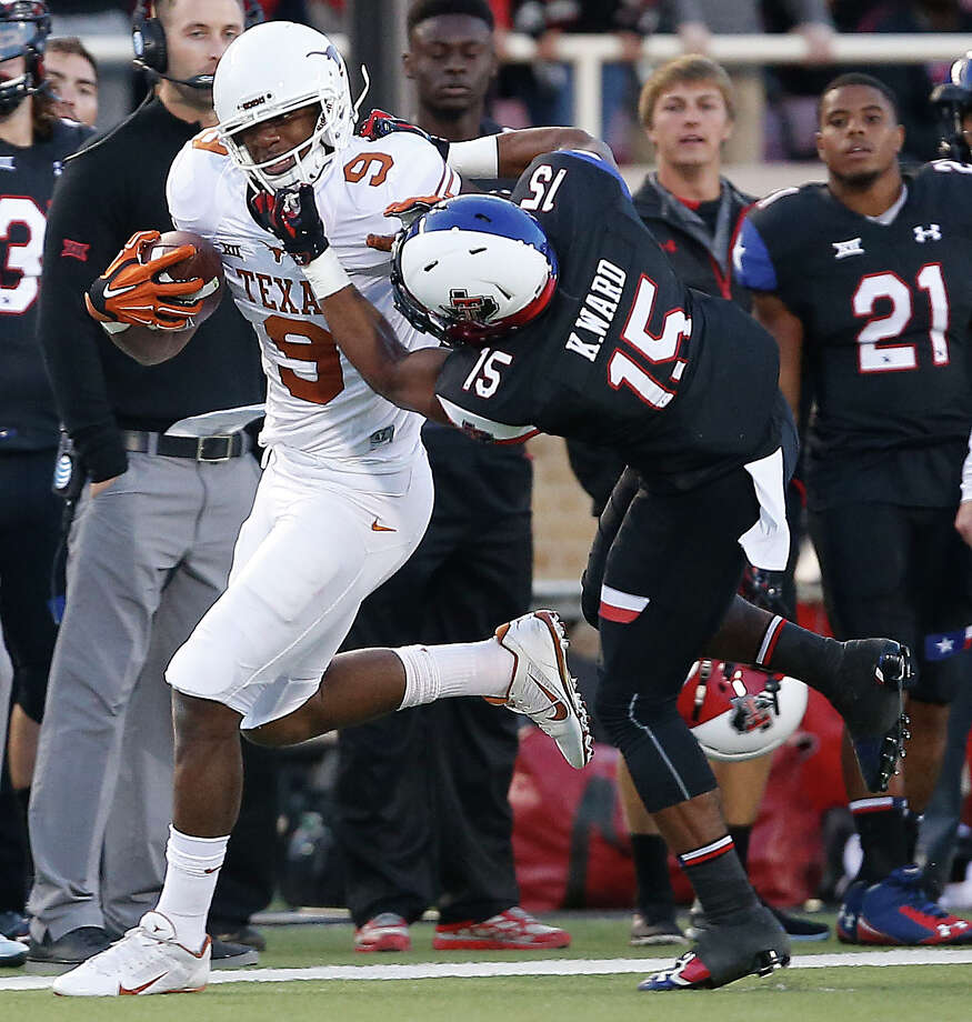 Texas' John Harris tries to get past Texas Tech's Keenon Ward during an NCAA college football game in Lubbock, Texas, Saturday, Nov. 1, 2014. (AP Photo/Lubbock Avalanche-Journal, Tori Eichberger) Photo: Tori Eichberger, MBI / Lubbock Avalanche-Journal