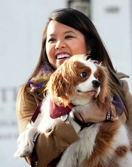 Nina Pham and Bentley reunite Saturday after his quarantine ended. Photo: Juan Guajardo, MBR / Fort Worth Star-Telegram