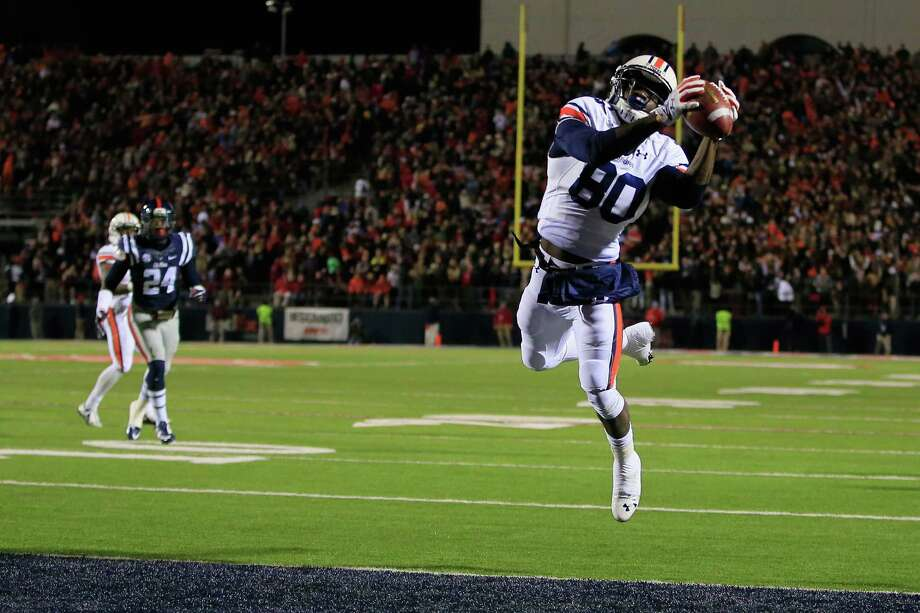 OXFORD, MS - NOVEMBER 01:  Wide receiver Marcus Davis #80 of the Auburn Tigers makes a 17 yard touchdown reception to take a 28-24 lead over the Mississippi Rebels in the third quarter at Vaught-Hemingway Stadium on November 1, 2014 in Oxford, Mississippi. Auburn defeated Mississippi 35-31.  (Photo by Doug Pensinger/Getty Images) ORG XMIT: 517702533 Photo: Doug Pensinger / 2014 Getty Images