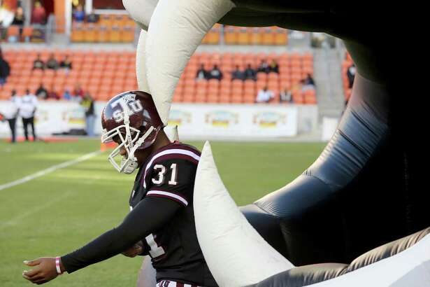 Texas Southern Tigers place kicker Cory Carter (31) walks onto the field before playing Grambling State Tigers in the fist half on November 1, 2014 at BBVA Stadium in Houston, TX.