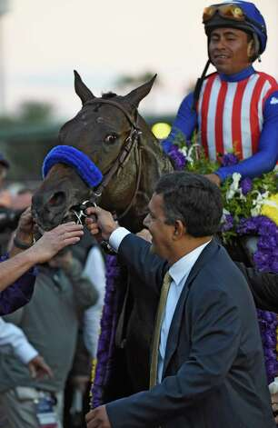 Bayern with jockey Martin Garcia is lead to the winner's circle by owner Kaleem Shah after winning the Breeders' Cup Classic Saturday evening Nov. 1, 2014 at Santa Anita Race Track in Arcadia, California     (Skip Dickstein/Times Union) Photo: SKIP DICKSTEIN