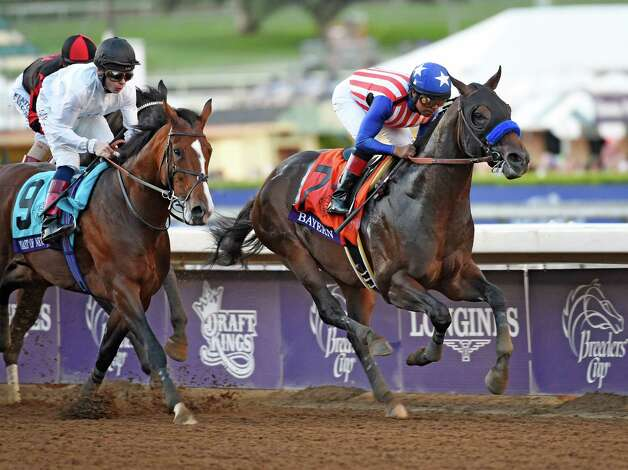 Toast of New York ,left, with jockey Jamie Spencer and Bayern with jockey Martin Garcia pass the wire for the first time in the Breeders' Cup Classic Saturday evening Nov. 1, 2014 at Santa Anita Race Track in Arcadia, California     (Skip Dickstein/Times Union) Photo: SKIP DICKSTEIN