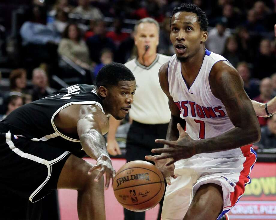 Detroit Pistons' Brandon Jennings (7) has the ball knocked away by Brookyn Nets' Joe Johnson, left, while driving to the basket during the second half of an NBA basketball game Saturday, Nov. 1, 2014, in Auburn Hills, Mich. The Nets defeated the Pistons 102-90. (AP Photo/Duane Burleson) ORG XMIT: DTP112 Photo: Duane Burleson / FR38952 AP