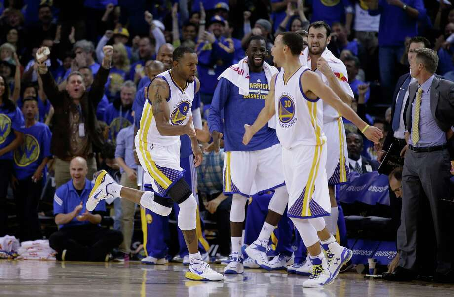 OAKLAND, CA - NOVEMBER 01:  Andre Iguodala #9 and Stephen Curry #30 of the Golden State Warriors react after Iguodala made a dunk against the Los Angeles Lakers at ORACLE Arena on November 1, 2014 in Oakland, California. NOTE TO USER: User expressly acknowledges and agrees that, by downloading and or using this photograph, User is consenting to the terms and conditions of the Getty Images License Agreement.  (Photo by Ezra Shaw/Getty Images) Photo: Ezra Shaw / Getty Images / 2014 Getty Images