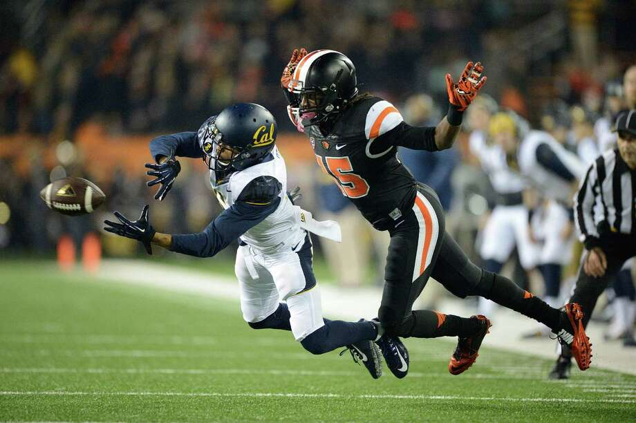 Oregon State cornerback Larry Scott (15) is called for pass interference against Cal receiver Chris Harper in the second quarter. Photo: TROY WAYRYNEN / Associated Press / FR32145 AP