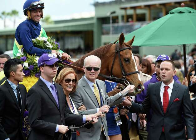 Trainer Chad Brown, right leads Dayatthespa with jockey Javier Castellano to the winner's circle after winning  the Breeders' Cup Filly & Mare Turf Saturday evening Nov. 1, 2014 at Santa Anita Race Track in Arcadia, California     (Skip Dickstein/Times Union) Photo: SKIP DICKSTEIN