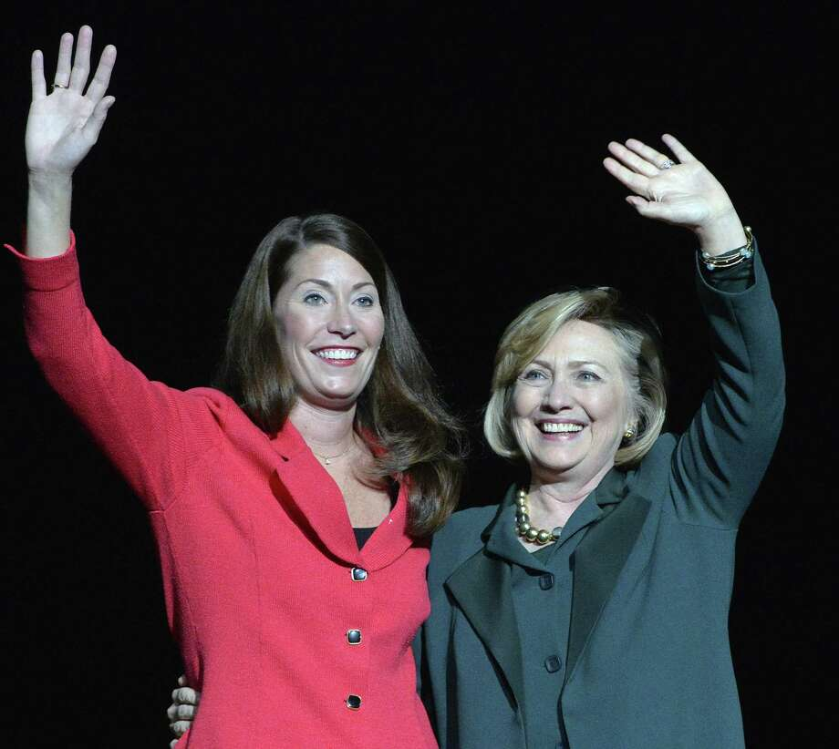 Kentucky democratic senatorial candidate Alison Lundergan Grimes (left) and former Secretary of State Hillary Clinton wave rally supporters in Highland Heights, Ky., on Saturday. Photo: Timothy D. Easley / Associated Press / FR43398 AP