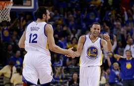 Stephen Curry, commended by Andrew Bogut (12) after an impressive assist, is a scintillating performer who dominates the debate over who's the best point guard.