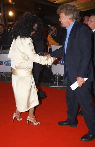 "LONDON - MARCH 15:  Diana Ross and Sir Richard Branson arrive at the ""Daily Mirror's Pride Of Britain Awards"" at the London Hilton Hotel on March 15, 2004, in London. The sixth annual reader-nominated awards celebrate heroism and bravery and are presented to heroes ranging from courageous children to extraordinary nurses and teachers. (Photo by Steve Finn/Getty Images) Photo: Steve Finn, Getty Images / 2004 Getty Images"