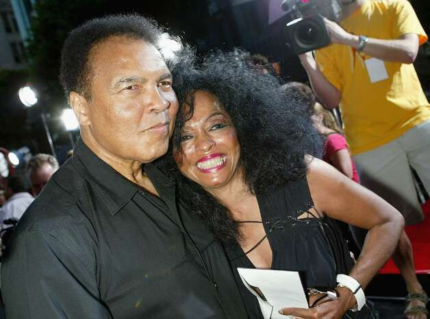 "LOS ANGELES - AUGUST 2:  Former heavyweight boxing champion Muhammad Ali and singer Diana Ross arrive at the World Premiere of ""Collateral"" at the Orpheum Theatre on August 2, 2004 in Los Angeles, California.  (Photo by Kevin Winter/Getty Images) Photo: Kevin Winter, Getty Images / 2004 Getty Images"