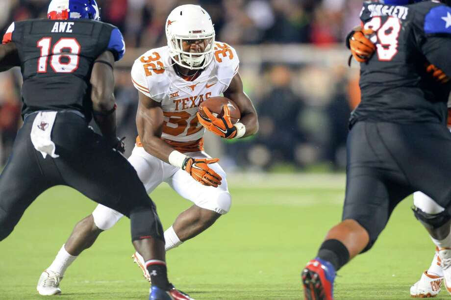 LUBBOCK, TX - NOVEMBER 1: Johnathan Gray #32 of the Texas Longhorns runs the ball against the Texas Tech Red Raiders on November 1, 2014 at Jones AT&T Stadium in Lubbock, Texas. Texas won the game 34-13 . Photo: John Weast, Getty Images / 2014 Getty Images