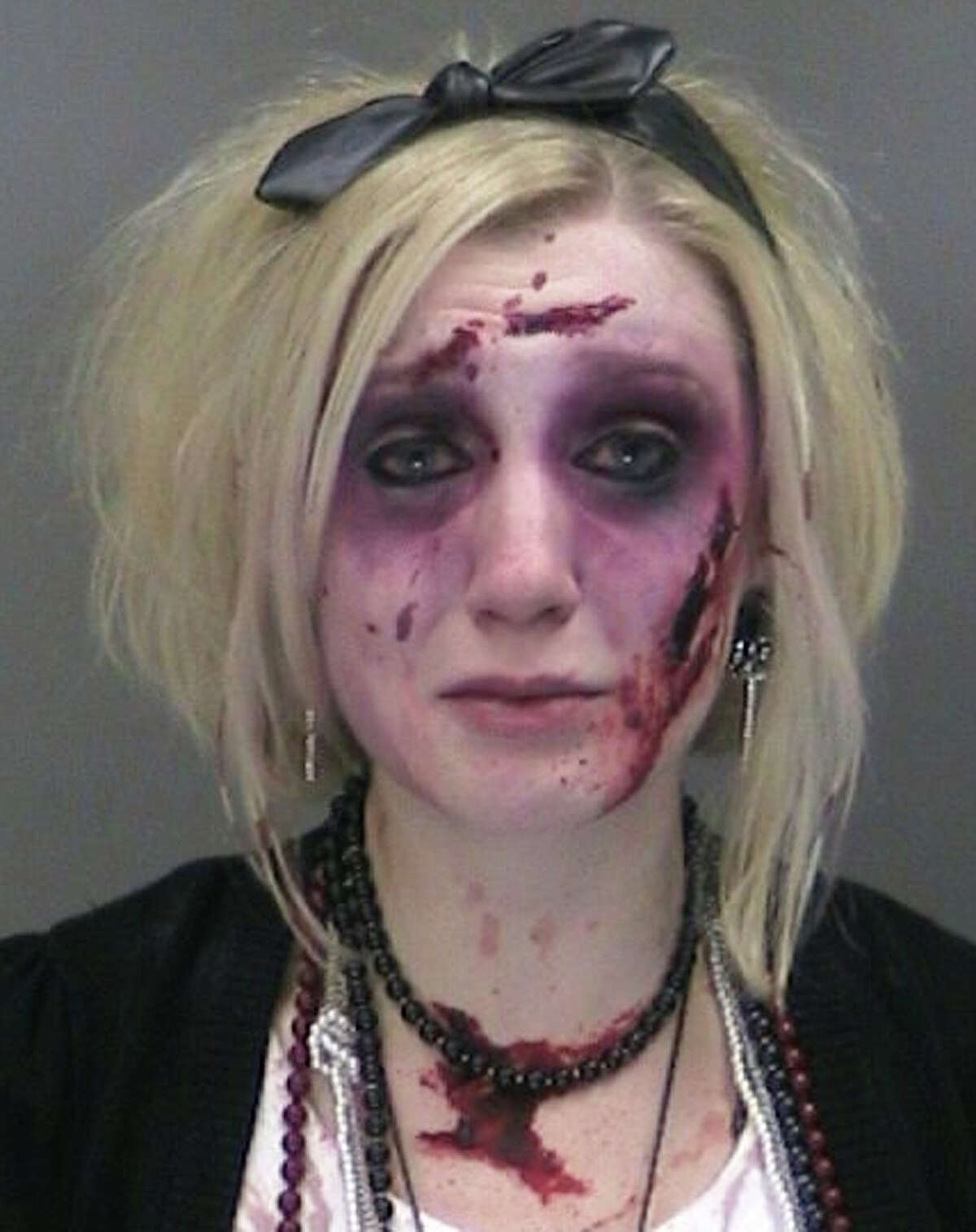 Catherine Butler of Rochester, N.Y. is seen in a booking photo provided by the Gates, N.Y., Police Department. Police say Butler, wearing a zombie costume and makeup, was charged with drunken driving twice within three hours Saturday, Oct. 25, 2014 after attending a Rochester bar's