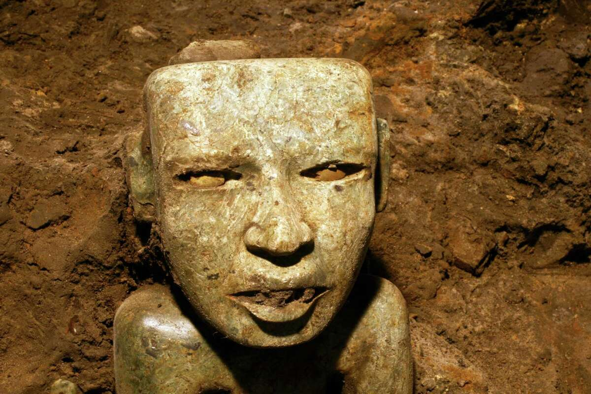 This Aug. 6, 2014 photo released by Mexico's National Institute of Anthropology and History (INAH) shows a sculpture unearthed at the Teotihuacan archeological site in Mexico. Mexican archaeologists have concluded a yearslong exploration of a tunnel sealed nearly 2,000 years ago at the ancient city of Teotihuacan and found thousands of relics. Teotihuacan dominated central Mexico centuries before the rise of the Aztecs in the 14th century.