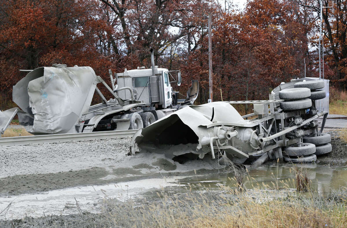 A semi-truck hauling cement lies in two pieces after an Amtrak train struck it about 8:30 a.m. Tuesday, Oct. 28, 2014, just east of the intersection of White County Road 200 North and Indiana 421 near Reynolds, Ind. The train was northbound and heading to Chicago when the accident took place. White County Sheriff Pat Shafer said 14 people complaining of pain were taken to local hospitals after the collision. The truck driver was not among the injured, he said.