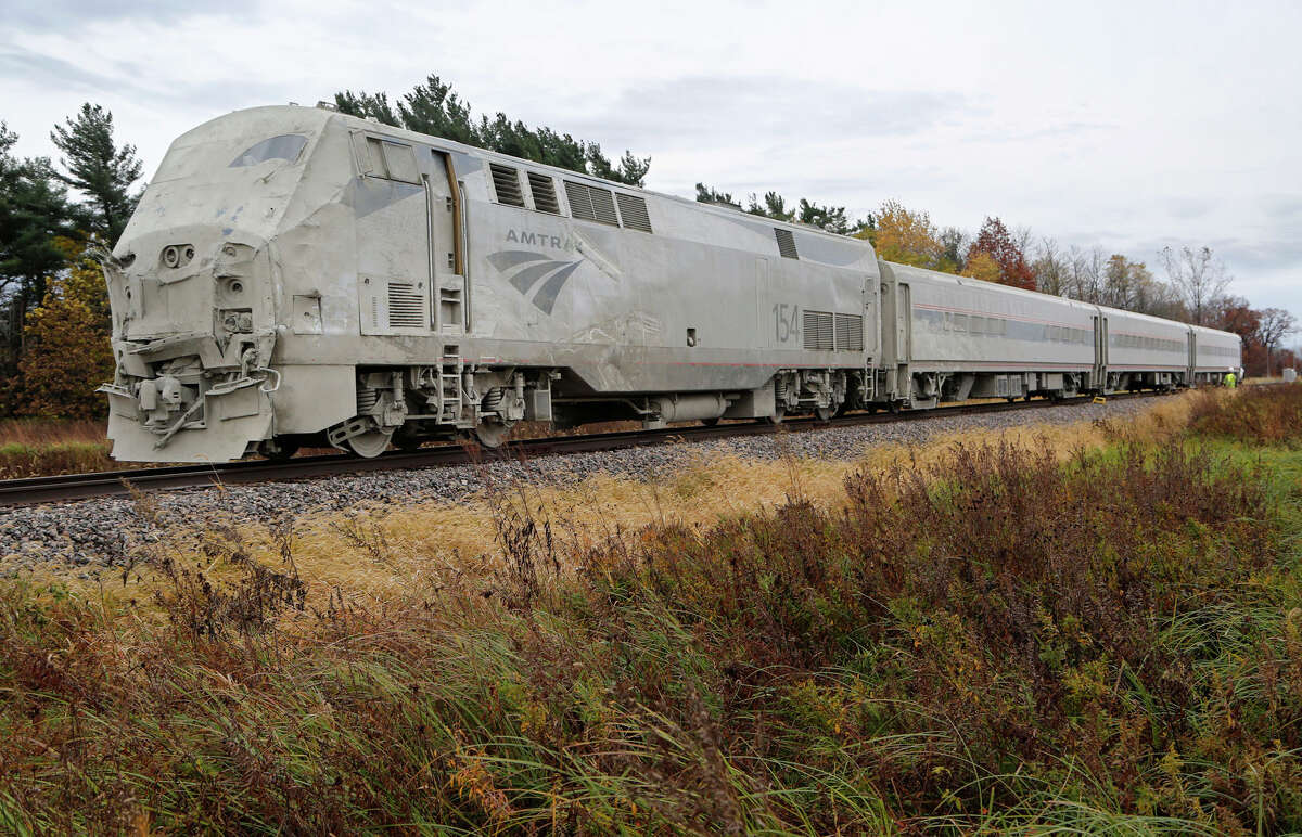 An Amtrak train sits idle on the tracks after hitting a semi-truck about 8:30 a.m. Tuesday, Oct. 28, 2014, just east of the intersection of White County Road 200 North and Indiana 421 near Reynolds, Ind. The train was northbound and heading to Chicago when the accident took place. White County Sheriff Pat Shafer said 14 people complaining of pain were taken to local hospitals after the collision. The truck driver was not among the injured, he said. The train came to a halt about a quarter mile north of the impact area.
