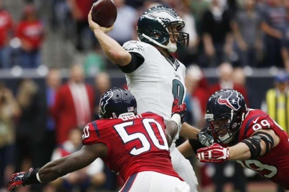 Houston Texans linebacker Akeem Dent (50) and defensive end J.J. Watt (99) apply pressure to Philadelphia Eagles quarterback Nick Foles (9) during the first quarter of an NFL football game at NRG Stadium on Sunday, Nov. 2, 2014, in Houston. ( Brett Coomer / Houston Chronicle )