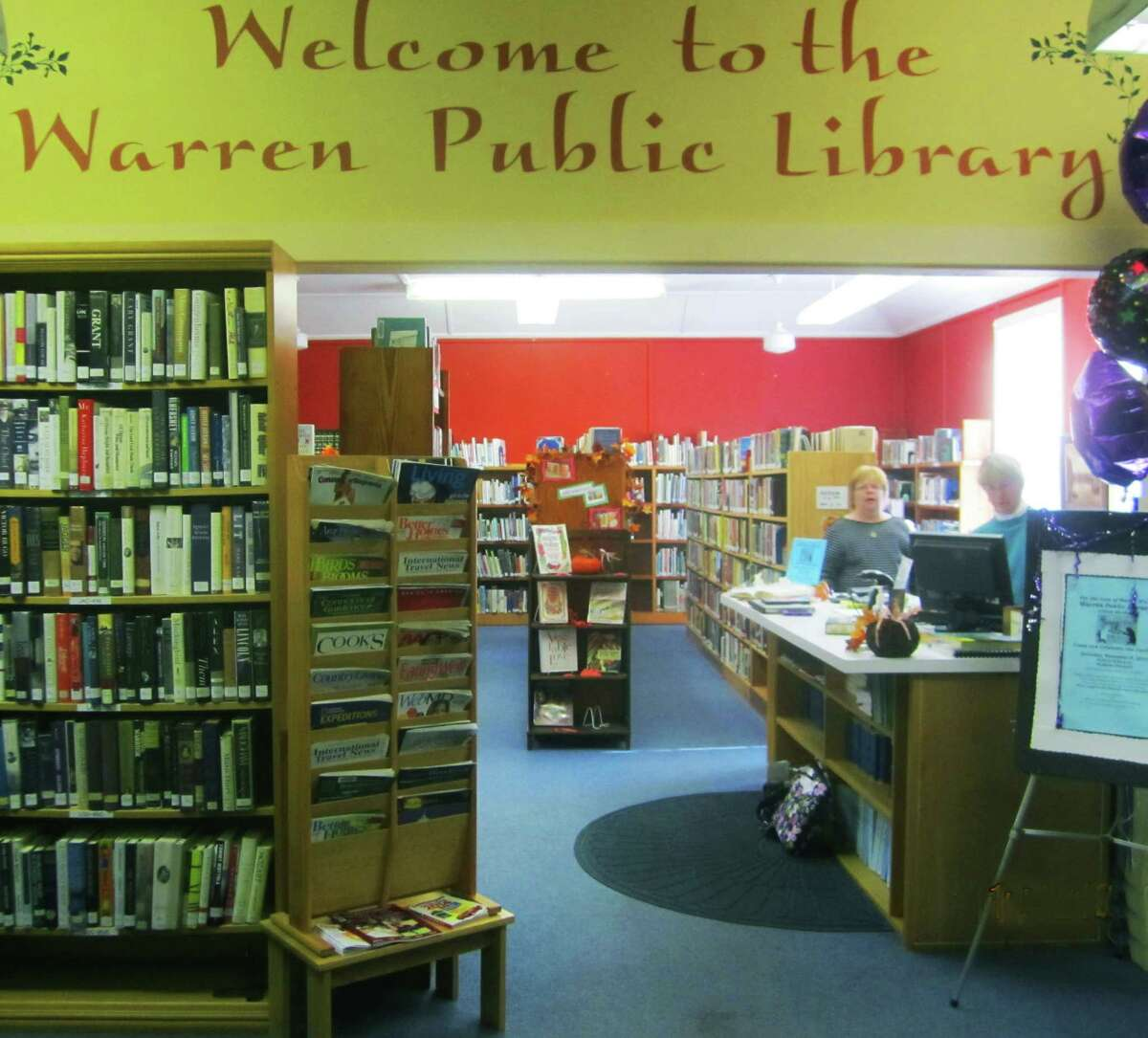 Warren Public Library offers a warm welcome to patrons as it celebrates its 100th anniversary in November 2014.