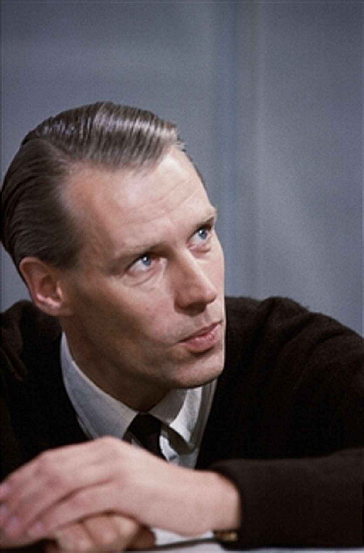 Beatles record producer George Martin was a classically trained musician, arranger and producer of comedy records. His impact on the Beatles sound was a key element in the band's success.