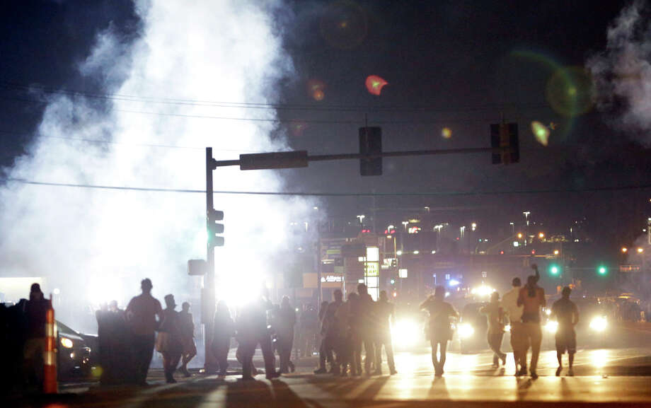 Audio recordings reveal a no-fly zone was requested to keep media helicopters away during protests over a police shooting in Ferguson, Mo., in August. Photo: Jeff Roberson / Associated Press / AP