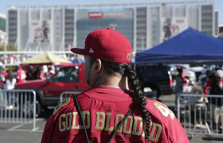 In this file photo, a San Francisco 49ers fan tailgates in the Levi's Stadium parking lot before a 49ers game.  Photo: Marcio Jose Sanchez, Associated Press