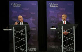 Gov. Jerry Brown, left, speaks next to Republican challenger Neel Kashkari during a gubernatorial debate in Sacramento in September.