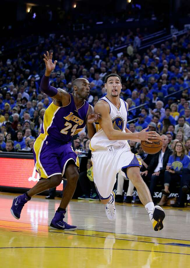 OAKLAND, CA - NOVEMBER 01:  Klay Thompson #11 of the Golden State Warriors drives on Kobe Bryant #24 of the Los Angeles Lakers at ORACLE Arena on November 1, 2014 in Oakland, California. NOTE TO USER: User expressly acknowledges and agrees that, by downloading and or using this photograph, User is consenting to the terms and conditions of the Getty Images License Agreement.  (Photo by Ezra Shaw/Getty Images) Photo: Ezra Shaw, Getty Images