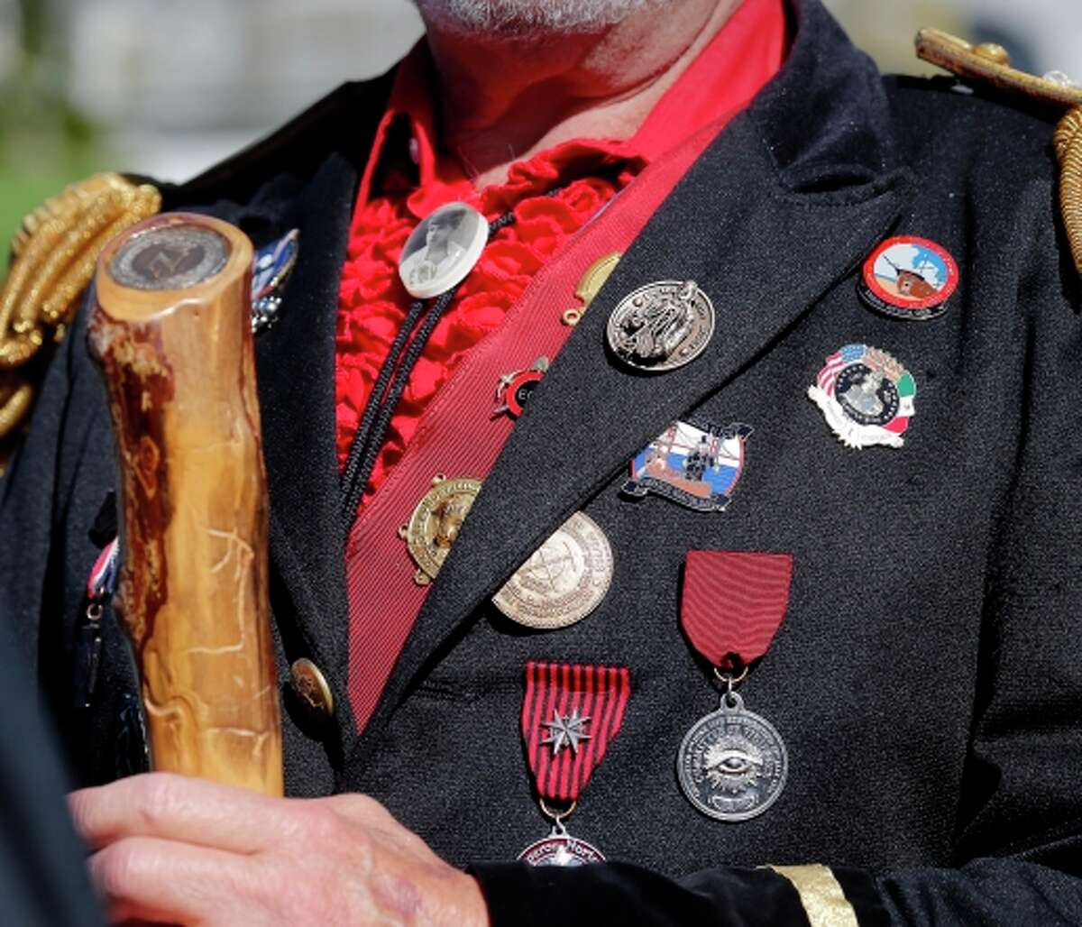 Emperor Norton, portrayed by actor Rick Saber, arrives with his medals to instruct cemetery guests.