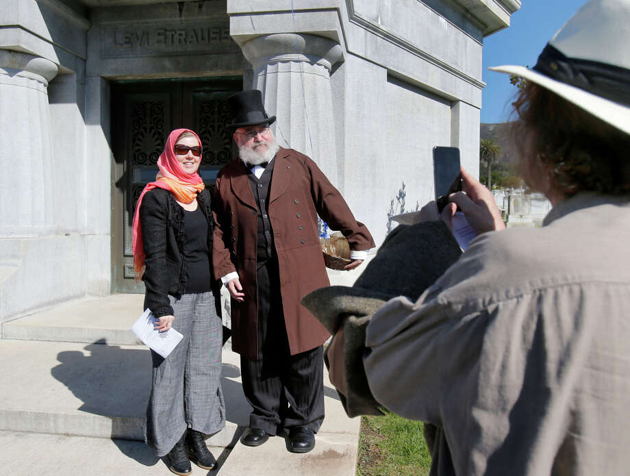 David Martin of Davis takes a picture of and Dena Martin with Daniel Will-Harris, portraying Levi Strauss. Photo: Brant Ward / The Chronicle / ONLINE_YES