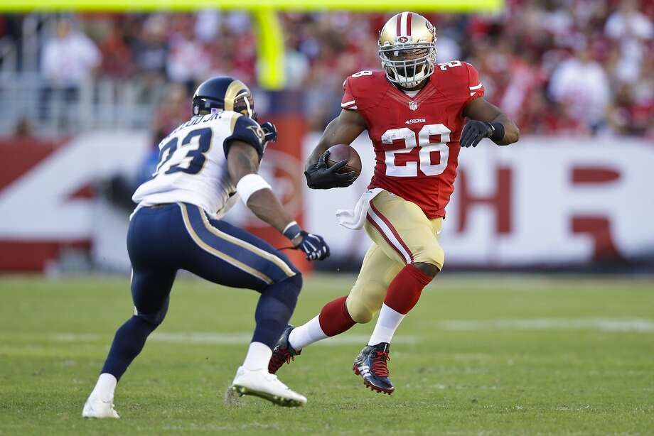 Carlos Hyde #28 of the San Francisco 49ers rushes towards Rodney McLeod #23 of the St. Louis Rams during the second half at Levi's Stadium on November 2, 2014 in Santa Clara, California. Photo: Ezra Shaw, Getty Images