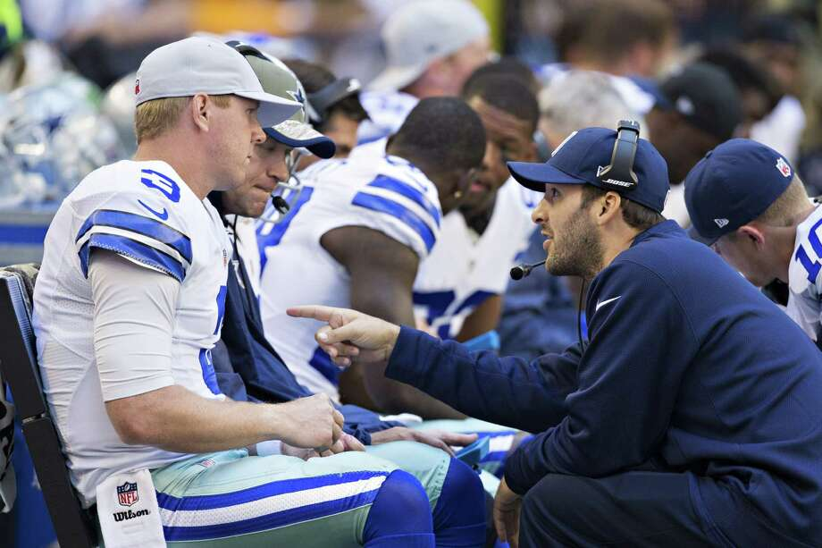 An injured Tony Romo, right, talks with Cowboys quarterback Brandon Weeden, who was 18-of-33 for 183 yards passing in place of Romo on Sunday. Photo: Wesley Hitt, Stringer / 2014 Getty Images