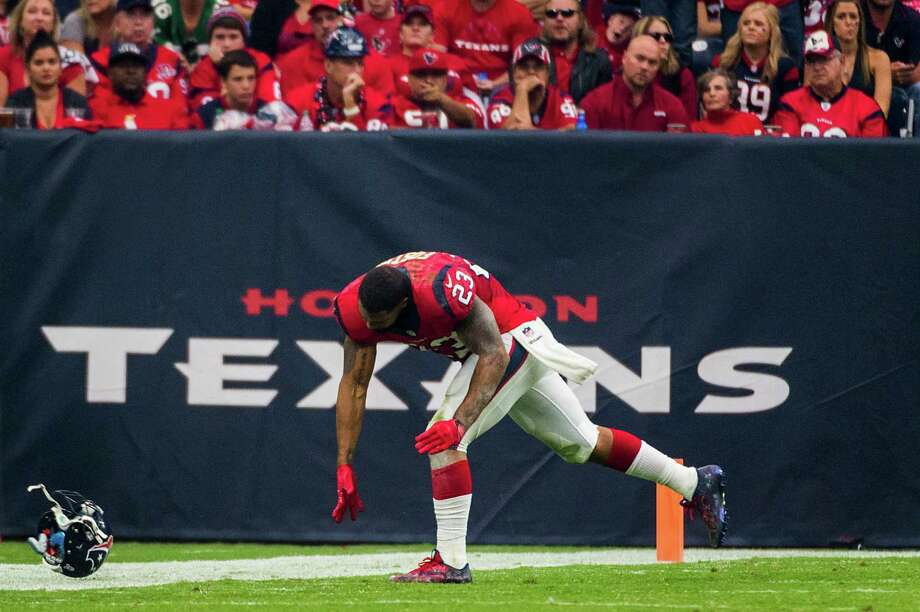 Texans running back Arian Foster saw red Sunday, and not just in the stands at NRG Stadium, as he slammed his helmet to the ground after suffering a groin injury. Photo: Smiley N. Pool, Staff / © 2014  Houston Chronicle