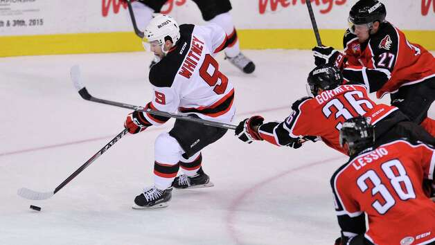 Joe Whitney of the Albany Devils skates towards the goal past Portland Pirates players at the Times Union Center on Sunday, Nov. 2, 2014, in Albany, N.Y.  (Paul Buckowski / Times Union) Photo: Paul Buckowski / 00029212C