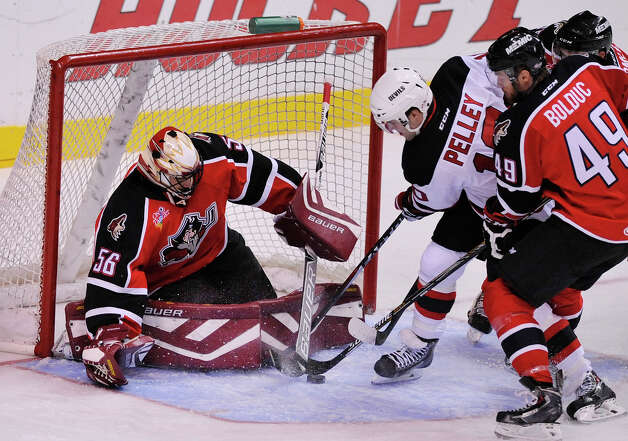 Rod Pelley of the Albany Devils tries to get to puck past goalie Mike McKenna of the Portland Pirates at the Times Union Center on Sunday, Nov. 2, 2014, in Albany, N.Y.  (Paul Buckowski / Times Union) Photo: Paul Buckowski / 00029212C