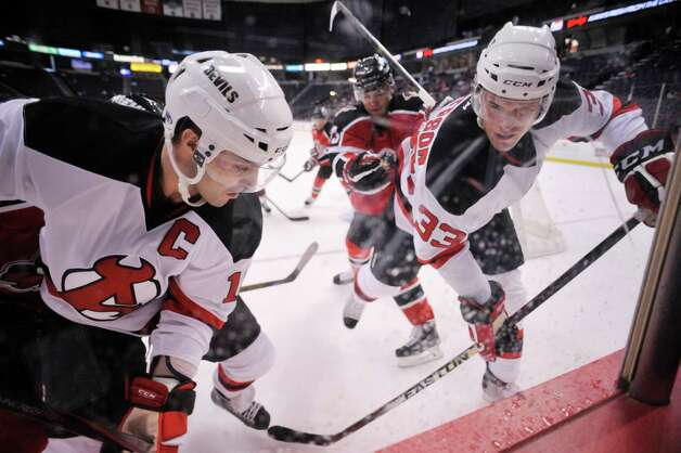 Rod Pelley, left, and Corbin McPherson of the Albany Devils control the puck along the boards in their game against the Portland Pirates at the Times Union Center on Sunday, Nov. 2, 2014, in Albany, N.Y.  (Paul Buckowski / Times Union) Photo: Paul Buckowski / 00029212C